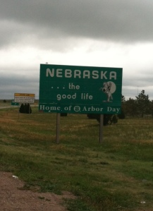 """State #1: this sign about tore up my car.  It snuck up on me and is a very unassuming sign.  Kinda like, """"Hey, looks like you're entering Nebraska.  It's a pretty long state. """""""